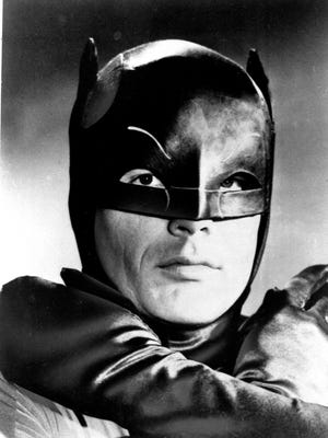 """FILE -- In this Jan. 23, 1966 file photo, actor Adam West, stars as the Caped Crusader battling the forces of evil on the new """"Batman"""" television series. """"Batman: The Complete Television Series,"""" available in limited edition Blu-ray as well as DVD and digitally, releases this week and includes the 120 original ABC broadcast episodes with guest stars that ranged from Liberace to Vincent Price to Bruce Lee. Three hours of new content includes interviews with West and co-star Burt Ward. (AP Photo, File)"""