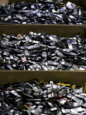 A prior generation of cellphones awaiting recycling are shown at ReCellular in Dexter, Mich., on Aug. 14, 2006.
