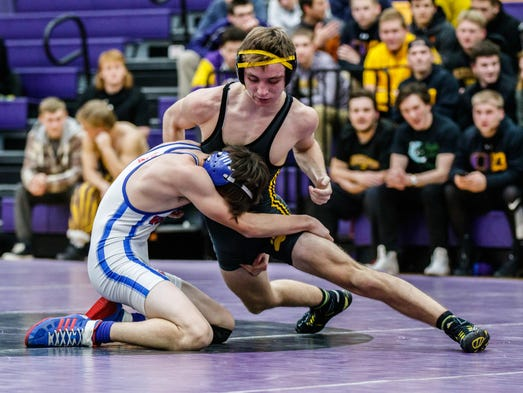 Oconomowoc sophomore Jackson Pratt (right) grapples