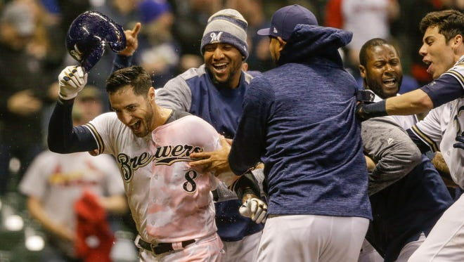 Ryan Braun is doused with Gatorade after his walk-off home run against the Cardinals on Tuesday night at Miller Park.