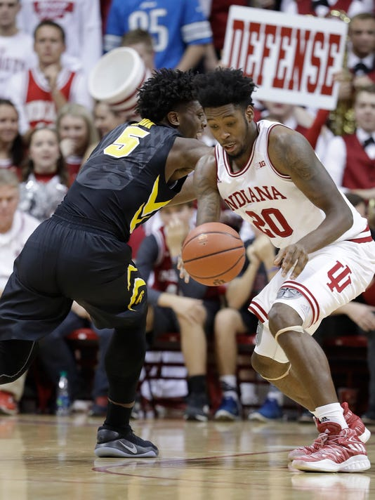 Indiana's De'Ron Davis steals the basketball from Iowa's Tyler Cook during the second half of an NCAA college basketball game, Monday, Dec. 4, 2017, in Bloomington, Ind. Indiana won 77-64. (AP Photo/Darron Cummings)