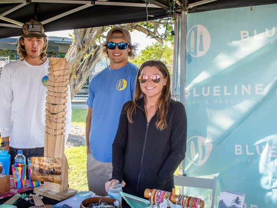 The Jupiter Seafood Festival was a weekend-long event with support from local businesses. The Blueline Surf and Paddle team, pictured, takes its place in the festivities.