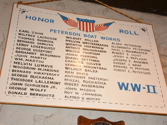 The plaque from PBI which hung in the office during World War II listing the Peterson Boat workers serving in the war. This hangs in the home of Carla Peterson Wednesday, May 9, 2018.