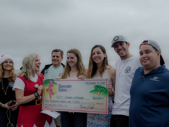 Bluewater Teen Babes presented Chasin A Dream Foundation with a check for $2,000. Pictured, from left, are Norma Huempfner, Lori Griffith, John Huempfner, Corri Kirvin, Sophie Smith, Jake Griffith and James Carriero.