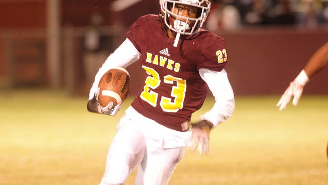 Omarion Buckmon, #23, led the Hawks with 72 yards rushing against the Trojans.