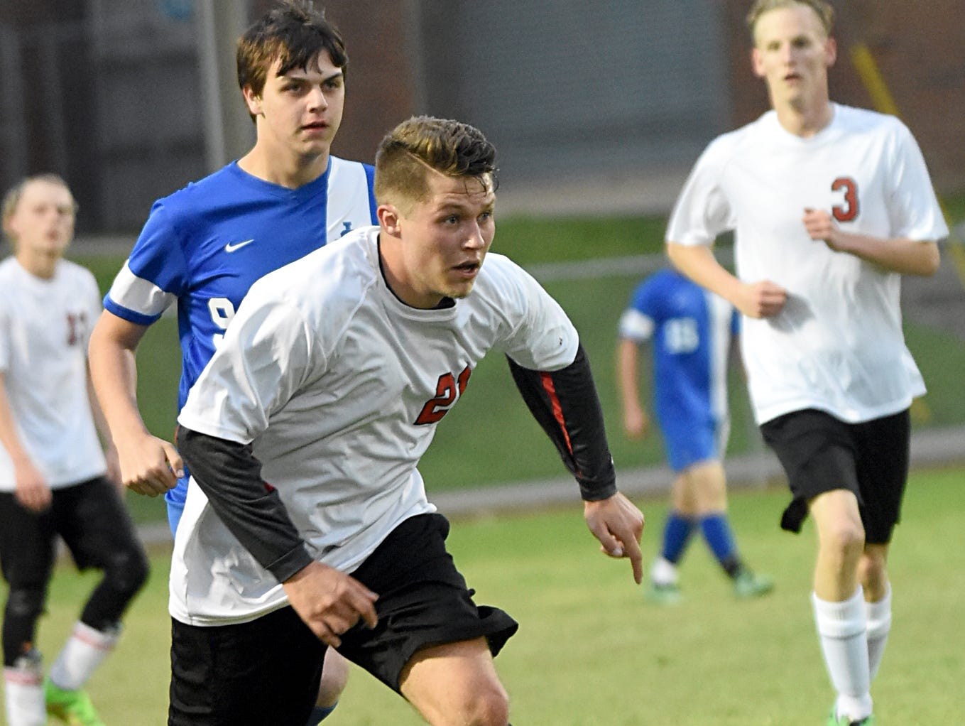 Westmoreland High senior defender Griffin Garrison dribbles upfield during the second half as Jackson County senior Cason Kinney pursues and as Eagle junior teammate Jesse Hovatter (3) looks on.