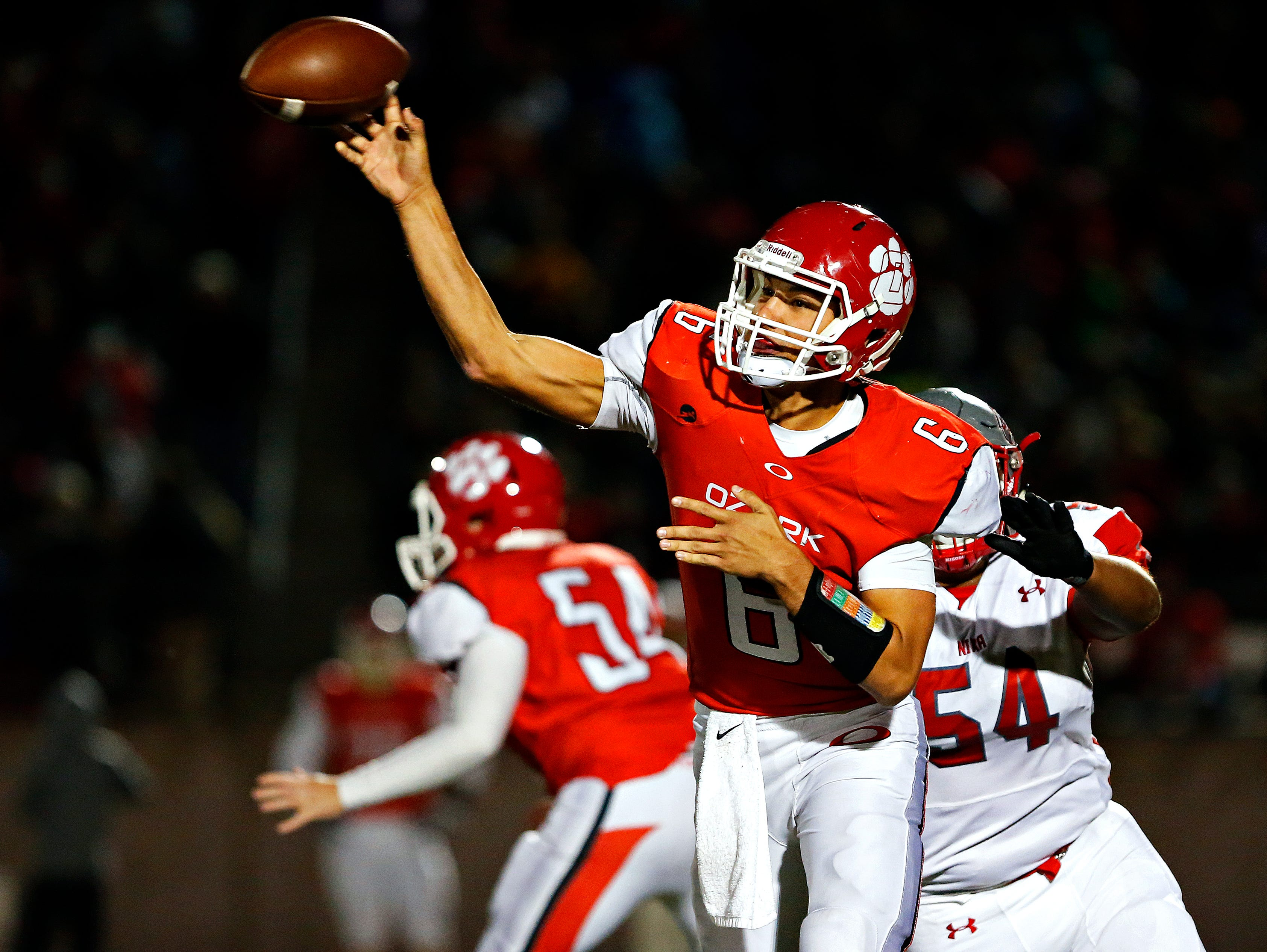 Ozark High School quarterback Jack Hulse (6) throws a pass during second quarter action of the game between Nixa High School and Ozark High School held at Tiger Stadium in Ozark, Mo. on Oct. 7, 2016.