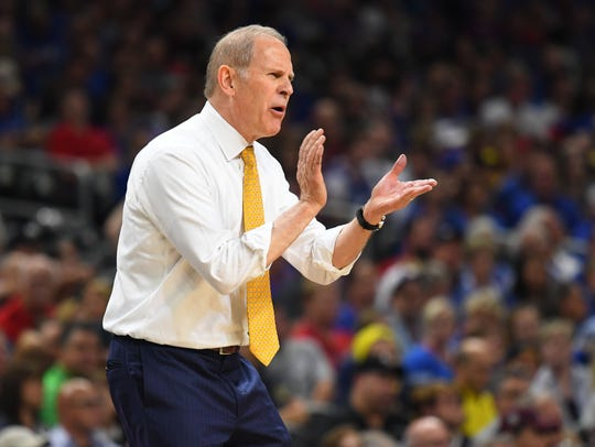 John Beilein has a 541-318 record as a college head coach in 26 seasons.