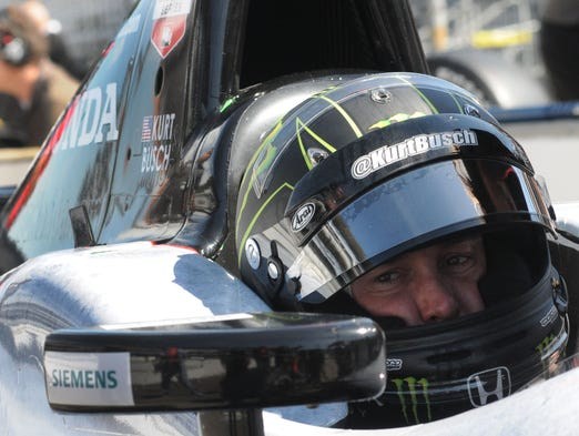 Kurt Busch checks the mirrors during rookie testing for the Indianapolis 500, Tuesday April 29, 2014 at The Indianapolis motor Speedway