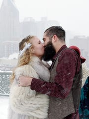 Jessica Reed and John Pyle kiss during their wedding