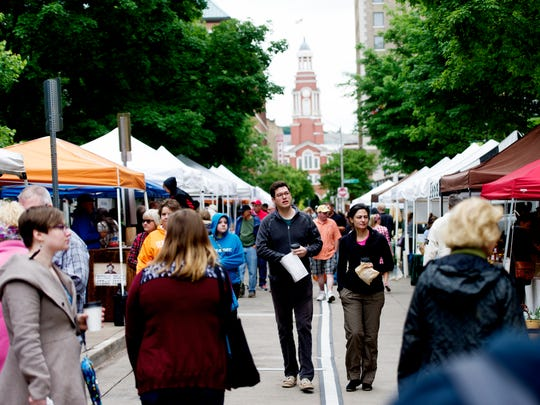 Shoppers stroll down Market Street during the opening day of the Knoxville Market Square Farmers Market in Knoxville, Tennessee on Saturday, May 6, 2017.