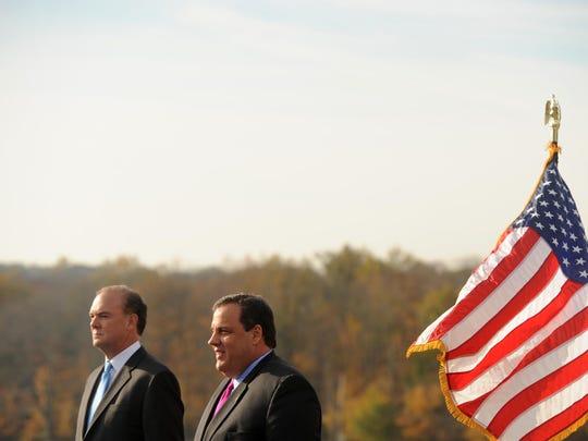 The state DEP, under commissioner Bob Martin, left,