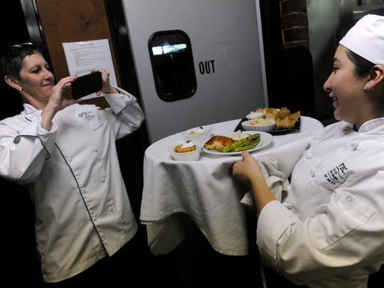 Chef instructor Kayleen Mills photographs Gissell Lomas
