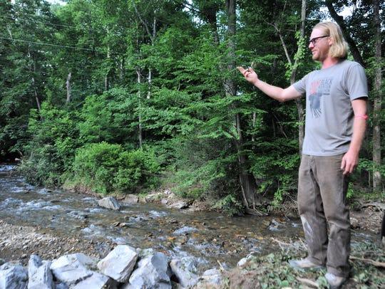 Dan Maresh surveys what used to be his backyard before