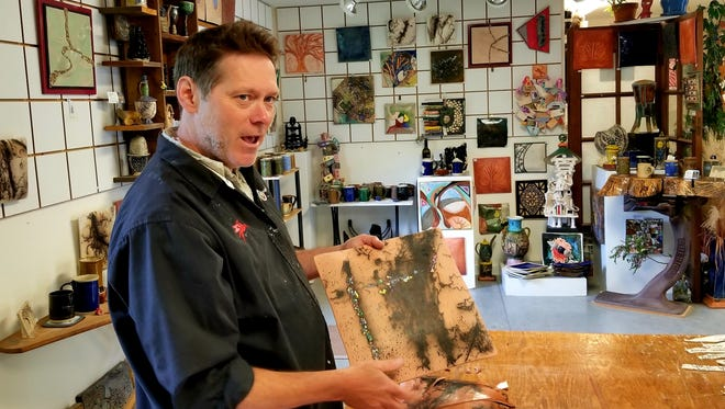 Mikel Kelley shows some of his ceramic art pieces at his studio/gallery at 109 E. Fourth St. in Mount Horeb.