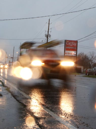 Traffic drives along Louisville Avenue in Monroe in the rain shortly after 7 a.m. on Thursday, March 10.