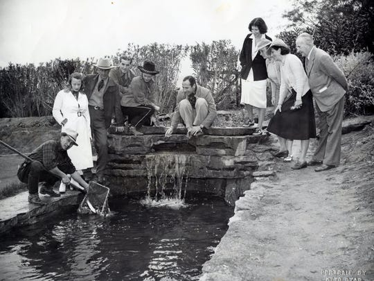 Trout in the ditch at the Tennis Club. Tony Burke in center, Pearl and Austin McManus on the far right. Photo by Otto Dyar.