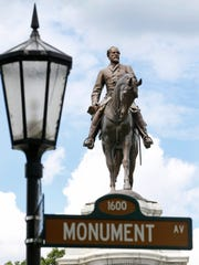 The statue of Robert E. Lee stands in a traffic circle on Monument Avenue in Richmond, Va., which is studying what to do with the Confederate memorials that dominate the stately boulevard.
