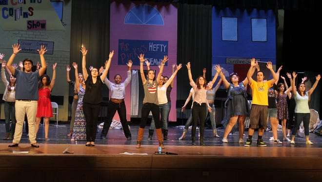 """Students at Mahopac High School rehearse a scene from the musical """"Hairspary"""" on the stage at Mahopac High School April 11."""