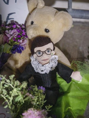 A Ruth Bader Ginsburg doll is placed at the Supreme Court to honor the late Justice Ruth Bader Ginsburg.
