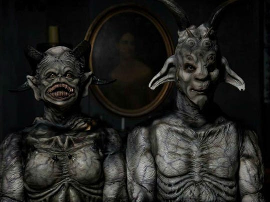 Guests walk alone through Horrorworld's Into The Dark experience