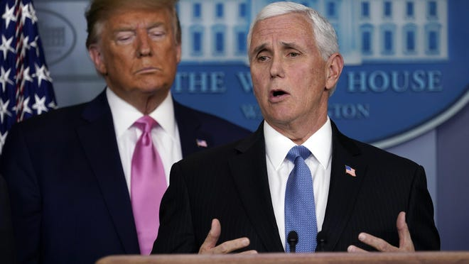 WASHINGTON -- Vice President Mike Pence speaks last Wednesday as President Donald Trump listens during a news conference about the coronavirus in the Brady Press Briefing Room of the White House.