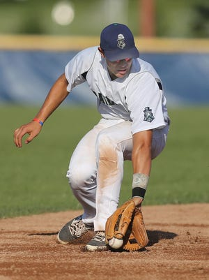Victor Railriders SS Dale Wickham makes a backhand grab to throw out the runner at first base.
