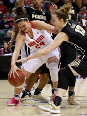 Ohio State forward Makayla Waterman (24) and Purdue forward Bridget Perry fight for a loose basketball during the second half of an NCAA college basketball game in the semifinals of the Big 10 conference tournament, Friday, March 4, 2017, in Indianapolis. (AP Photo/R Brent Smith)