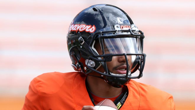 Oregon State quarterback Marcus McMaryion looks for a pass during a  scrimmage on Saturday, Aug. 15, 2015, in Corvallis, Ore.