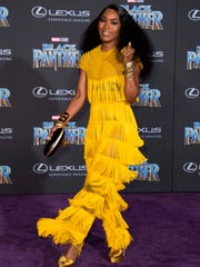 "Angela Bassett, 59, shines at the ""Black Panther"" premiere."