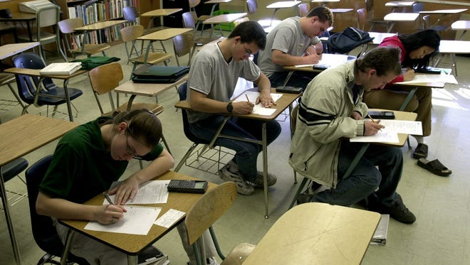 A class of five calculus students at Hug High School take an exam in an advanced placement class in 2003.