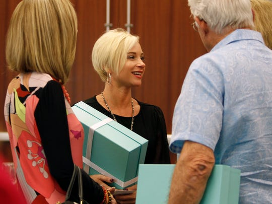 Sonya Sawyer, center, chats with fellow Southwest Florida Wine & Food Fest Dinner hosts Friday in Fort Myers.