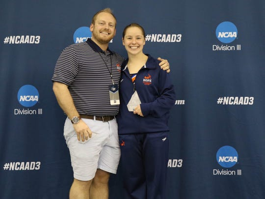 Richmond High School graduate Sarah Sheridan, right, stands with Hope College diving coach Zach Golin. Sheridan won the NCAA Division III 3-meter diving national championship.