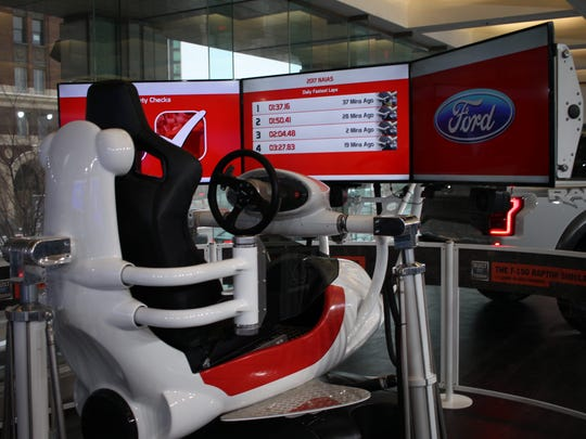 One of the Ford F-150 Raptor dueling simulators inside the Cobo Center hallway at the North American International Auto Show on Jan. 10, 2016 in Detroit.