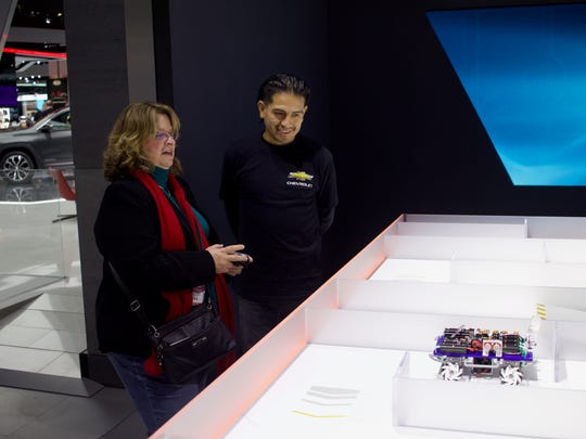Chevrolet's tech studio allows visitors to control a small mechanical car through a maze-like track inside the North American International Auto Show showroom on Jan. 10, 2016 at Cobo Center in Detroit.