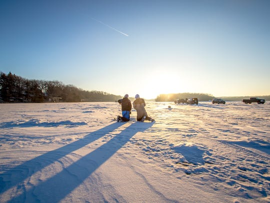 The sun rises over Horseshoe Lake while Ice Team members plan out the cutting of holes for the day's fishing. Channel catfish in Horseshoe Lake were the target for Ice Team University 2018, held last month at Bug-Bee Hive Resort in Paynesville.