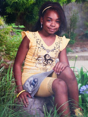 Stray bullets which hit several homes on Hathaway Drive and Heywood Lane in Sicklerville also injured 13-year-old Tiya Hudson, Monday, July 7, 2014.