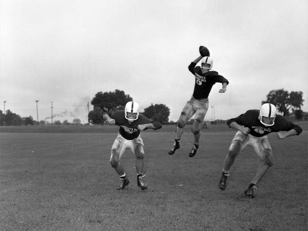 The jump pass was used long before Tim Tebow did it for the Florida Gators. In this photo, football players from Florida High in 1960 demonstrate its usage during a practice.