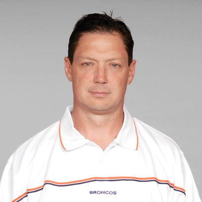 Rick Dennison of the Denver Broncos poses for his 2005