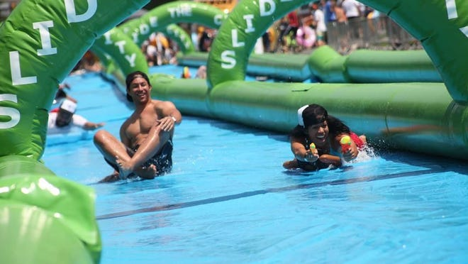 Slide the City may be sold out, but there are opportunities to participate on the sidelines.