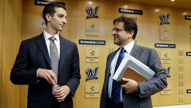 In this Sept. 2015 file photo, Milwaukee Brewers general manager David Stearns (left), talks to owner Mark Attanasio at a news conference in Milwaukee.