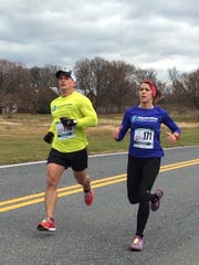 Chambersburg's Jason Huber, left and Amy Shelly run in the Cash Dash Bonanza 10K last weekend in Chambersburg. Huber ran a 42:29 in his 10K debut while Shelly posted a 48:14 for a PR.