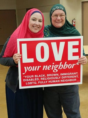 The Rev. Sue Ringler (right) stands with her friend Elena Coassolo, a Muslim woman who showed a room full of Christian women how to wear a hijab.