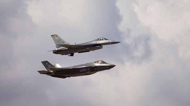 The current F-16, above, and an F-35 fly over the west valley following a Luke Air Force Base F-35 Lightning II unveiling ceremony in Glendale, Ariz., on March 14.