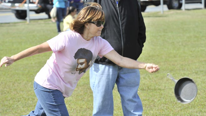 Beverly Wescott, of Newark, competes in the ladies skillet toss at the Bridgeville Apple Scrapple Festival.