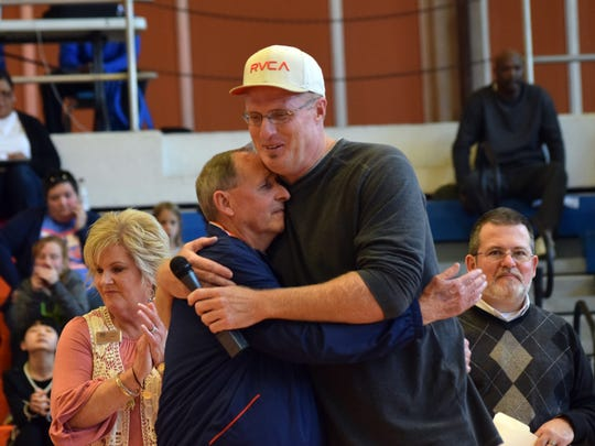 Pastor Lowell Lucas (right), who played for Gene Rushing (left) on the  Louisiana College Wildcats basketball team from 1987-1992, hugs Rushing Saturday at a ceremony honoring the coach who retired after 40 years.