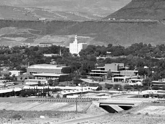In August of 1988 Spectrum photographer Nancy Rhodes took a series of images looking out over St. George and Washington cities from the Eastridge development on top of Foremaster Ridge. This image from the series shows the St. George Temple of the Church of Jesus Christ of Latter-day Saints and most of the Dixie College campus in addition to numerous other businesses and buildings in downtown St. George. The east side of Interstate 15 was completely empty in 1988 and the university campus has also undergone dramatic changes.