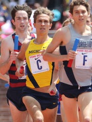Colin Daly (back left) formerly of River Dell High School, runs the first leg of the 4x1mile at the Penn Relays in Philadelphia. Saturday, April 29, 2017