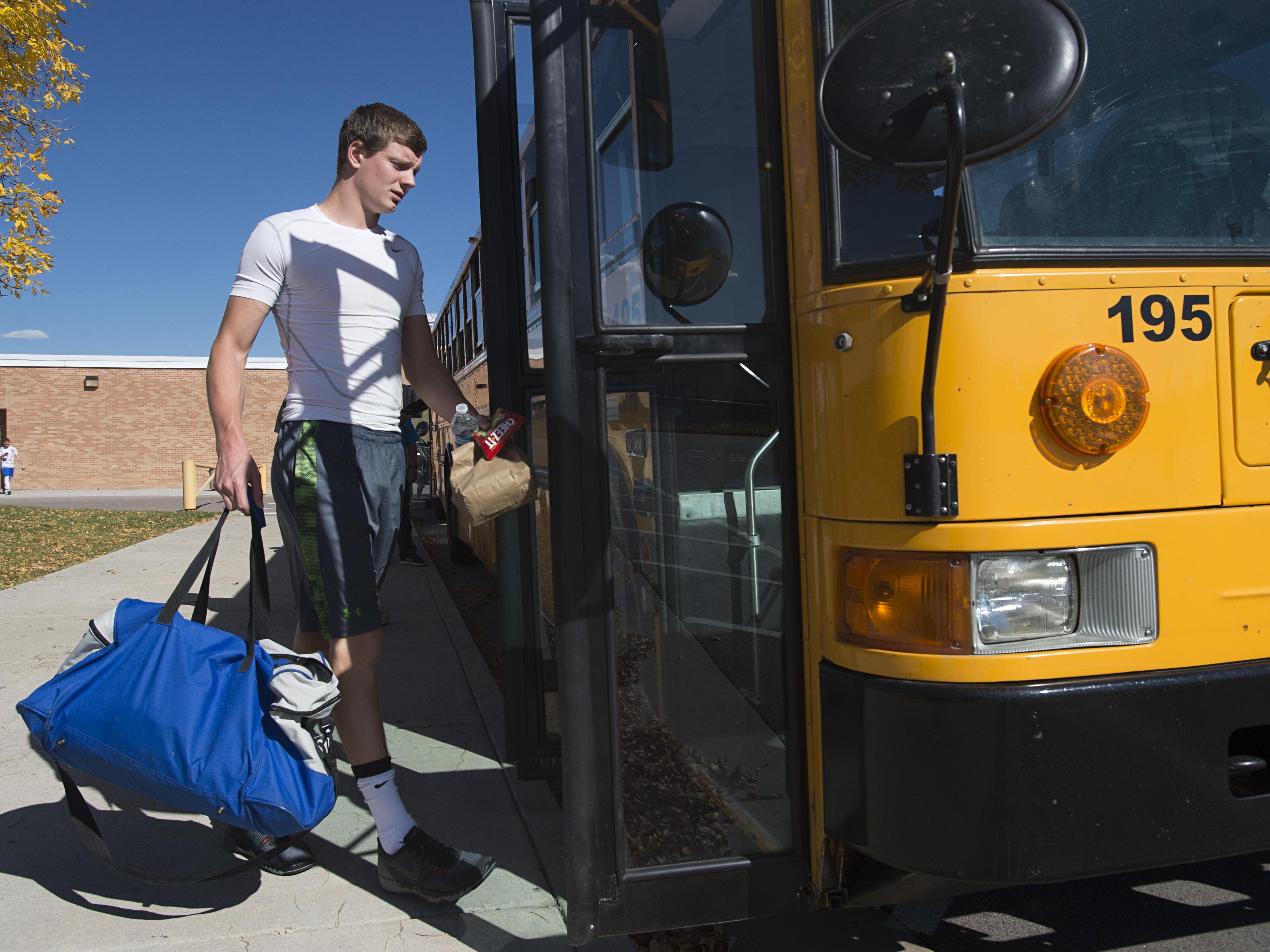 2:12 p.m. - Poudre High School quarterback James Campbell boards the bus to travel to Parker, a nearly 100-mile trip, for a conference game against Legend High School Thursday, October 13, 2016.