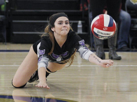 Mission Oak's Kelsey Brown digs one out against Bakersfield Christian during a Central Section Division III championship volleyball game held in Lemoore, Calif., Saturday, Nov. 12, 2016 in the Golden Eagle Arena at West Hills College.